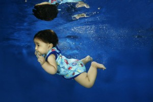 Child swimming wearing a Baby Wrap swimming costume from SplashAbout - Image copyright SplashAbout